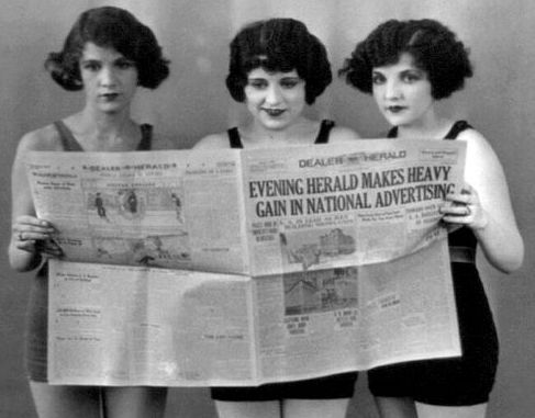 Flappers reading a newspaper