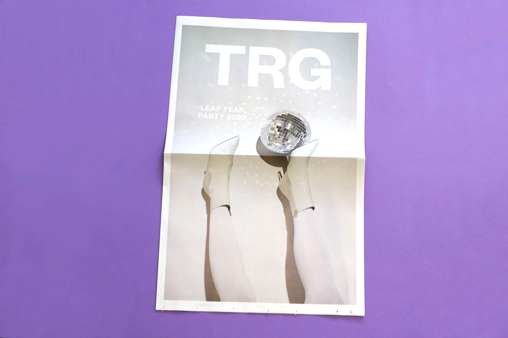 Invitation to TRG Multimedia's leap year party. Printed as a broadsheet newspaper by Newspaper Club.
